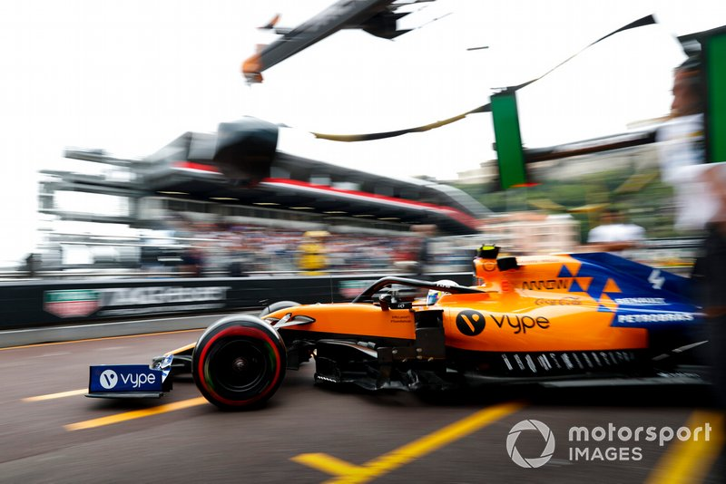 Lando Norris, McLaren MCL34 drives out of the garage