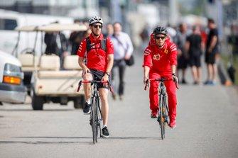 Sebastian Vettel, Ferrari arrives in the paddock on a bike