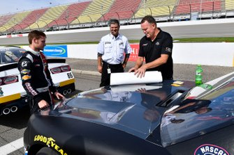 Dillon Bassett, DGM Racing, Chevrolet Camaro DGM Racing installs sponsor decals before qualifying.