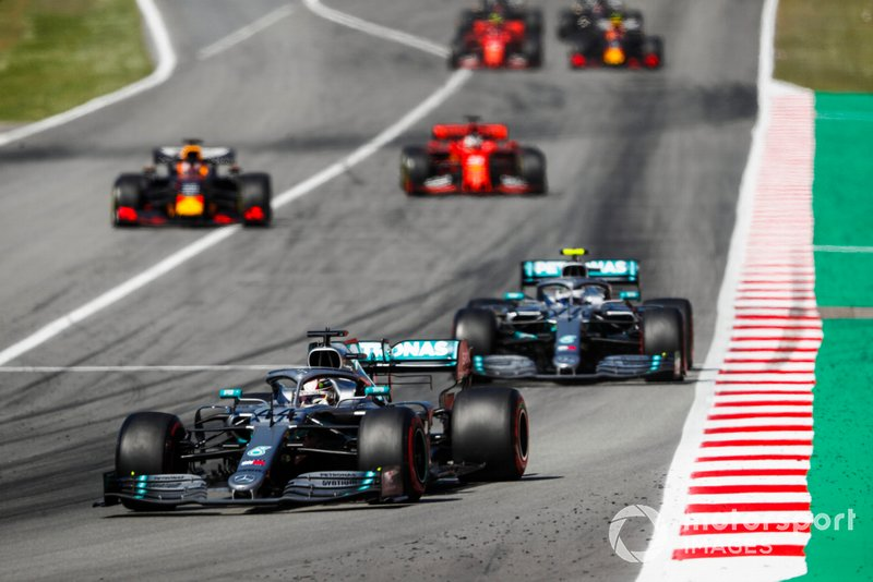 Lewis Hamilton, Mercedes AMG F1 W10 leads Valtteri Bottas, Mercedes AMG W10 after the Safety Car