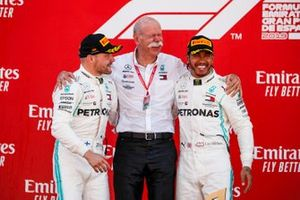 Valtteri Bottas, Mercedes AMG F1, 2nd position, Dr Dieter Zetsche, CEO, Mercedes Benz, and Lewis Hamilton, Mercedes AMG F1, 1st position, on the podium
