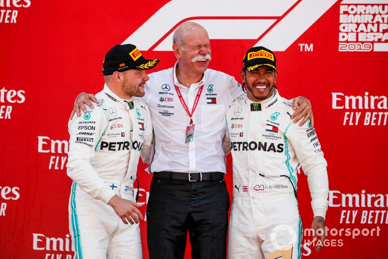 Valtteri Bottas, Mercedes AMG F1, 2nd position, Dr Dieter Zetsche, CEO, Mercedes Benz, and Lewis Hamilton, Mercedes AMG F1, 1st position, on the podium
