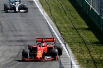 Sebastian Vettel, Ferrari SF90 leads Lewis Hamilton, Mercedes AMG F1 W10