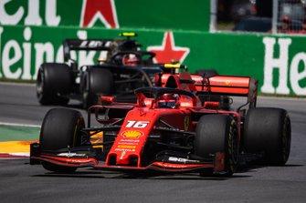 Charles Leclerc, Ferrari SF90, leads Kevin Magnussen, Haas VF-19