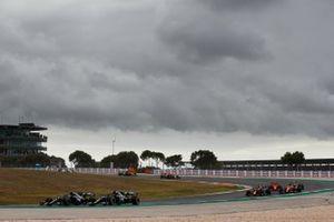 Lewis Hamilton, Mercedes F1 W11, battles with Valtteri Bottas, Mercedes F1 W11, at the start