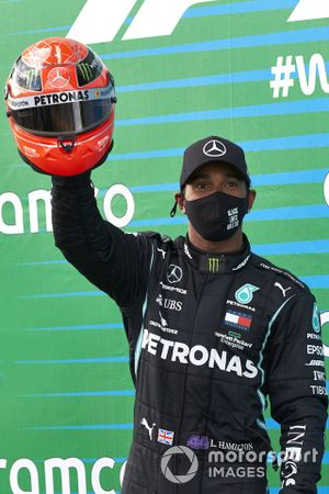 Lewis Hamilton, Mercedes-AMG F1, 1st position, with the helmet of Michael Schumacher after equalling his record 91 race wins