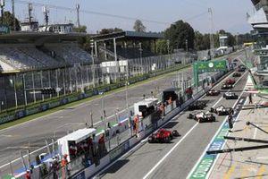 Esteban Ocon, Renault F1 Team R.S.20, Romain Grosjean, Haas VF-20, Kevin Magnussen, Haas VF-20, and Charles Leclerc, Ferrari SF1000, out of the pits