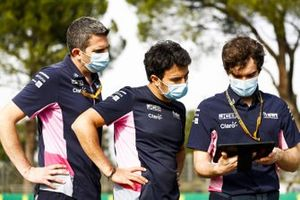 Sergio Perez, Racing Point, walks the track with team mates