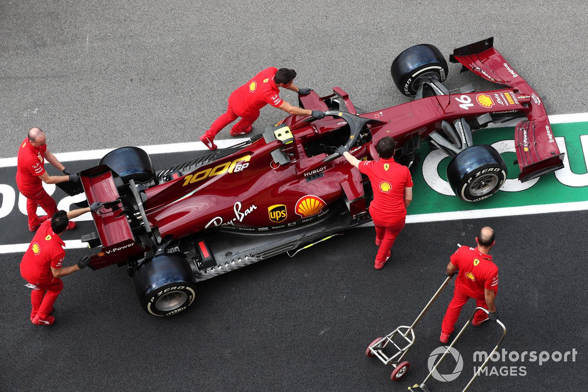 Mechanics push the Charles Leclerc Ferrari SF1000