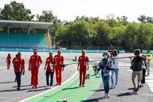 Sebastian Vettel, Ferrari, walks the track whilst being filmed