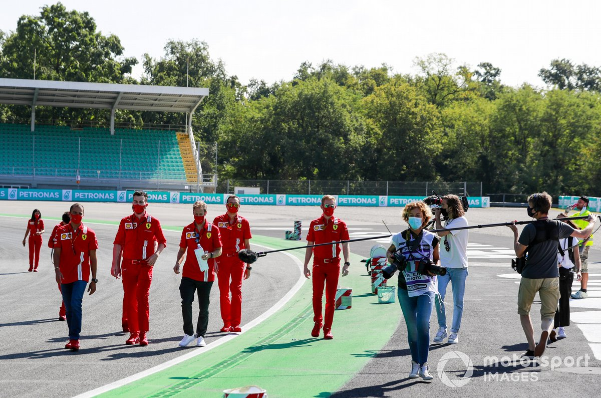 Sebastian Vettel, Ferrari, walks the track whilst being filmed