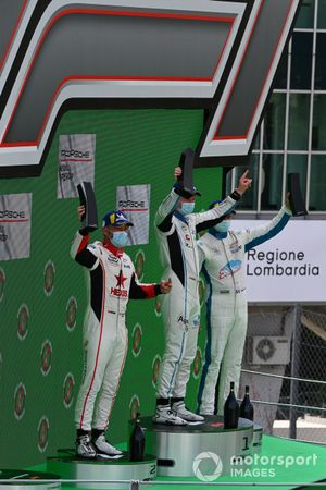 Clement Mateu, Pierre martinet by Almeras, 2nd position, Roar Lindland, Pierre martinet by Almeras, 1st position, and Roland Berville, Pierre martinet by Almeras, 3rd position, on the podium