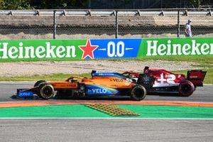 Carlos Sainz Jr., McLaren MCL35 overtakes Kimi Raikkonen, Alfa Romeo Racing C39
