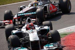 Michael Schumacher, Mercedes GP W02, Lewis Hamilton, McLaren MP4-26
