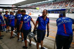 Toro Rosso engineers in the pit lane