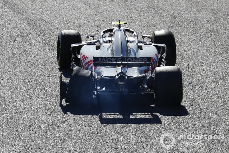Kevin Magnussen, Haas F1 Team VF-18, with his rear tyre burst after connecting with Charles Leclerc, Sauber C37