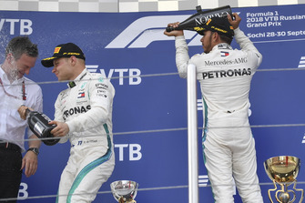 James Allison, Mercedes AMG F1 Technical Director, Valtteri Bottas, Mercedes AMG F1 and Lewis Hamilton, Mercedes AMG F1 celebrate with the champagne on the podium