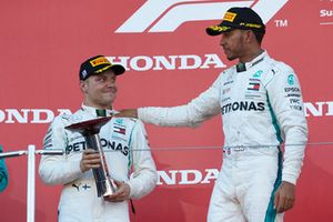 Lewis Hamilton, Mercedes AMG F1, celebrates his win on the podium with Valtteri Bottas, Mercedes AMG F1, with his trophy