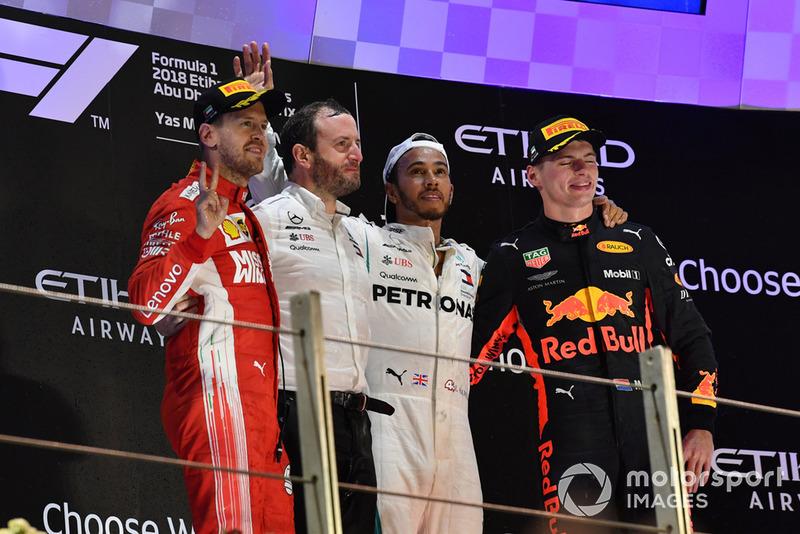 (L to R): Sebastian Vettel, Ferrari, Bradley Lord, Head of Mercedes-Benz Motorsport Communications, Lewis Hamilton, Mercedes AMG F1 and Max Verstappen, Red Bull Racing celebrate on the podium