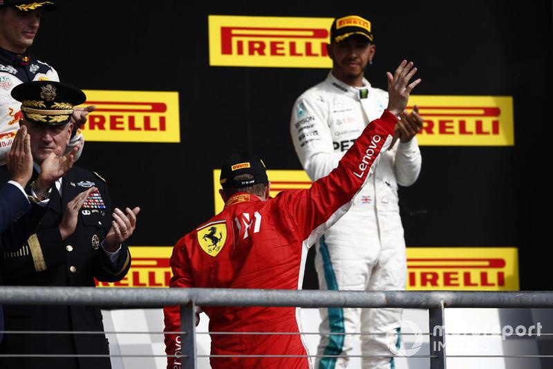 Kimi Raikkonen, Ferrari, 1st position, and Lewis Hamilton, Mercedes AMG F1, 3rd position, on the podium