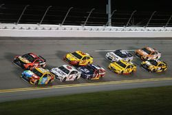 Kyle Busch, Joe Gibbs Racing Toyota, and Martin Truex Jr., Furniture Row Racing Toyota, lead a pack of cars during the Monster Energy NASCAR Cup Series Can-Am Duel 1