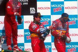 Podium: race winner Jean Alesi, Ferrari, second place Rubens Barrichello, Jordan, third place Eddie