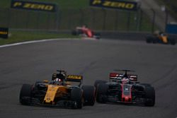 Nico Hulkenberg, Renault Sport F1 Team RS17, leads Romain Grosjean, Haas F1 Team VF-17
