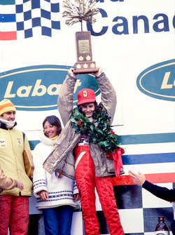 Podium: race winner Gilles Villeneuve, Ferrari, third place Carlos Reutemann, Ferrari