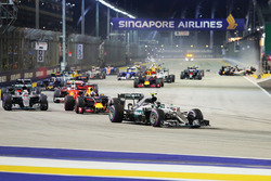 Nico Rosberg, Mercedes AMG F1 W07 Hybrid leads at the start of the race as Nico Hulkenberg, Sahara Force India F1 VJM09 crashes out