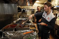 Romain Grosjean, Haas F1 Team cooks up some ribs at Mac's Speed Shop