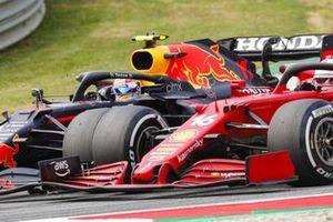 Sergio Perez, Red Bull Racing RB16B, battles with Charles Leclerc, Ferrari SF21