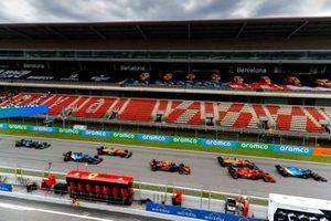 Esteban Ocon, Alpine A521, leads Charles Leclerc, Ferrari SF21, Daniel Ricciardo, McLaren MCL35M, Sergio Perez, Red Bull Racing RB16B, Lando Norris, McLaren MCL35M, Fernando Alonso, Alpine A521, and Lance Stroll, Aston Martin AMR21, at the start
