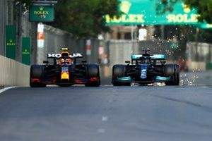 Sergio Perez, Red Bull Racing RB16B, battles with Lewis Hamilton, Mercedes W12