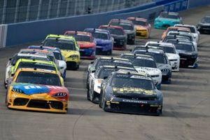 Kyle Busch, Joe Gibbs Racing, Toyota Supra M&M's and Justin Allgaier, JR Motorsports, Chevrolet Camaro Unilever Dollar General LF