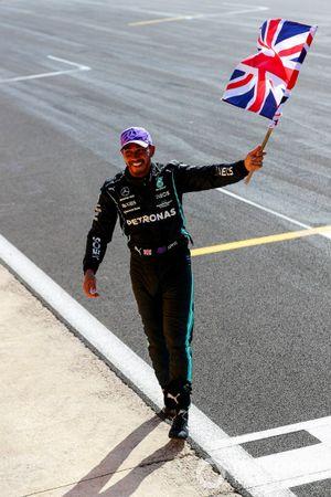 Lewis Hamilton, Mercedes, 1st position, celebrates with Union flag
