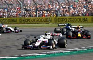 Mick Schumacher, Haas VF-21, Sergio Perez, Red Bull Racing RB16B, Nicholas Latifi, Williams FW43B, and Nikita Mazepin, Haas VF-21