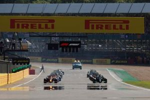 Lewis Hamilton, Mercedes W12, and Max Verstappen, Red Bull Racing RB16B, preapre to lead the field away