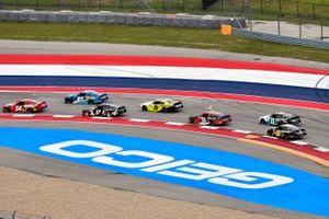 Kyle Busch, Joe Gibbs Racing, Toyota Supra Skittles Gummies and Cole Custer, SS Green Light Racing, Chevrolet Camaro Production Alliance Group