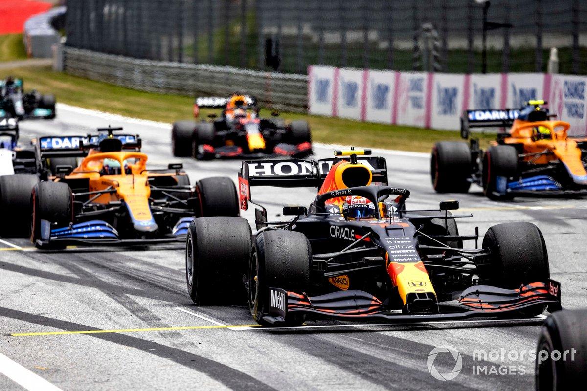 Sergio Perez, Red Bull Racing RB16B, Daniel Ricciardo, McLaren MCL35M, and Lando Norris, McLaren MCL35M