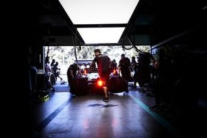 Lewis Hamilton, Mercedes W12, is returned to the garage