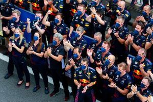 The Red Bull Racing team cheer for Max Verstappen, Red Bull Racing, 1st position, on the podium