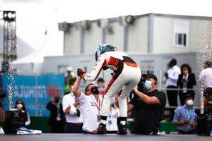Rene Rast, Audi Sport ABT Schaeffler, second position, celebrates with a team mate