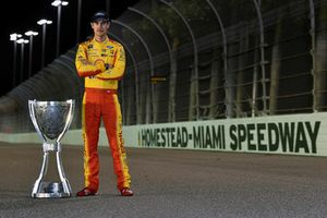 Joey Logano, Team Penske, Ford Fusion Shell Pennzoil with his Championship trophy