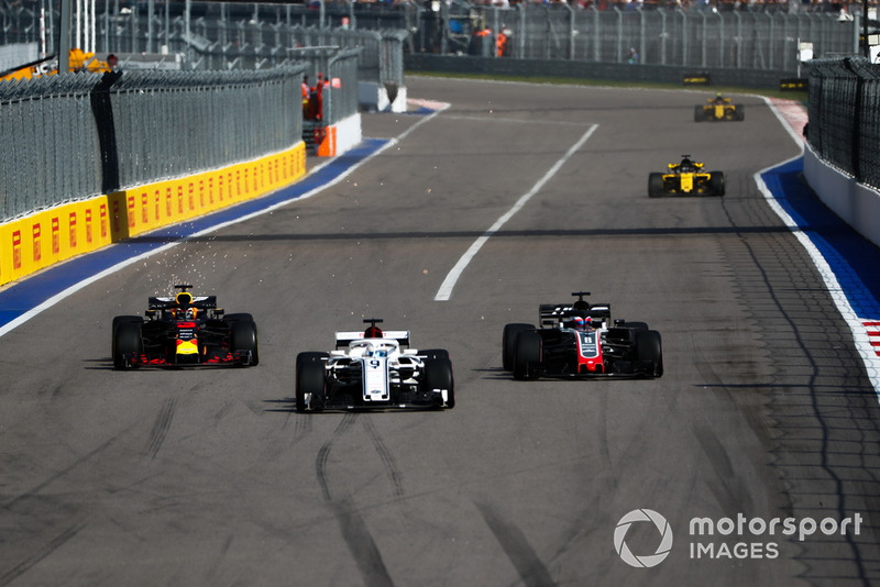 Marcus Ericsson, Sauber C37, leads Romain Grosjean, Haas F1 Team VF-18, and Daniel Ricciardo, Red Bull Racing RB14