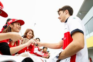 Charles Leclerc, Sauber, signs an autograph for fans