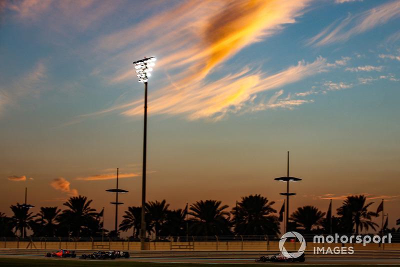 Fernando Alonso, McLaren MCL33, leads Charles Leclerc, Sauber C37, Carlos Sainz Jr., Renault Sport F1 Team R.S. 18, and Romain Grosjean, Haas F1 Team VF-18