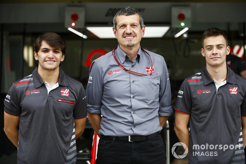 Guenther Steiner, Team Principal, Haas F1, poses with test and development drivers Pietro Fittipaldi and Louis Deletraz.