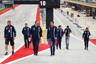 The Racing Point Force India team walk the track.