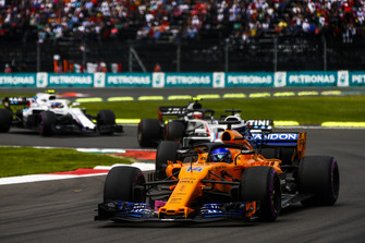 Fernando Alonso, McLaren MCL33, leads Lance Stroll, Williams FW41, Kevin Magnussen, Haas F1 Team VF-18, and Sergey Sirotkin, Williams FW41
