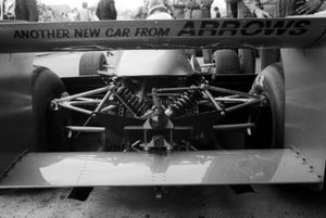 The Arrows team arrived in Austria with the new Arrows A1 after a court ruling had found the old FA/1 to infringe Shadow's copyright. The rear wing contains the message: Another new car from Arrows.